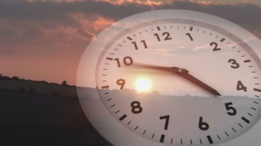Ticking clock over sunset — Stock Video