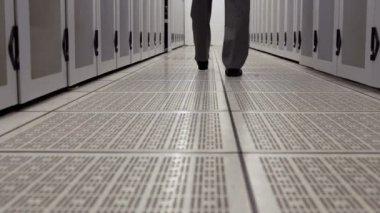 Data technician walking through locker hall — Stock Video