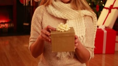 Pretty blonde opening gift at christmas — Stock Video