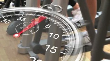 Stopwatch graphic over cross trainers at gym — Stock Video
