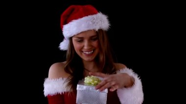 Smiling woman opening Christmas present — Stock Video