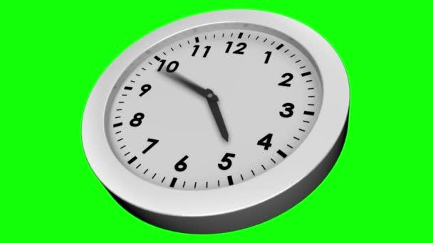 Reloj sobre fondo verde — Vídeo de stock