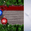 Christmas baubles hanging over wood — Stock Photo #62466421