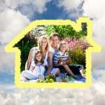 Cute family enjoying a picnic — Stock Photo #62467923