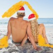 Rear view of couple sitting on beach — Stock Photo #62468655
