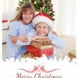 Brother and sister holding Christmas presents — Stock Photo #62469131