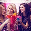 Composite image of friends drinking cocktails — Stock Photo #62469597