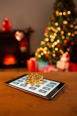 Tablet with bow for christmas — Stockfoto