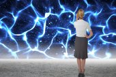 Businesswoman against glowing blue lights — Foto Stock