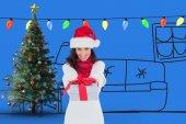 Festive brunette giving gift — Stok fotoğraf