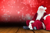 Santa sits next to his bag — Foto de Stock