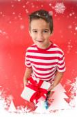 Festive little boy holding gift — Stock Photo