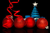 Four red christmas ball decoration — Photo