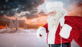 Festive santa claus checking time — Stock Photo