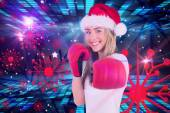 Festive blonde punching with boxing gloves — Stock Photo