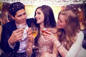 Composite image of friends toasting — Stock Photo