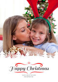 Mother kisses daughter at Christmas — Stock Photo