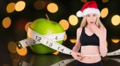 Fit festive young blonde measuring her waist — Stock Photo