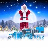 Composite image of santa is shocked to camera — Stockfoto