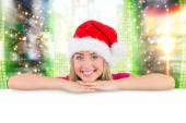 Festive blonde leaning on large poster — Stock Photo
