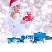 Disappointed blonde opening christmas gift — Stock Photo