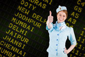 Air hostess with hand on hip — Stock Photo