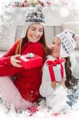 Mother and daughter exchanging gifts at christmas — Stok fotoğraf