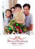 Family decorating Christmas tree — Stock Photo