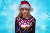 Festive blonde holding hands out — Stock Photo