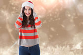 Composite image of festive brunette smiling at camera — Stock Photo