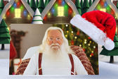 Composite image of happy santa without his jacket — Stock Photo
