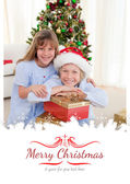 Brother and sister holding Christmas presents — Stock Photo