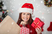 Festive redhead holding christmas gifts — Stock fotografie