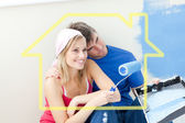 Affectionate couple painting a room — Stock Photo