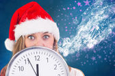 Festive blonde showing a clock — Stock Photo