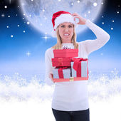 Stressed blonde holding gifts — Stock Photo
