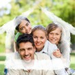 Composite image of happy family in the park — Stock Photo #62470197