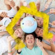 Teenagers on the floor with a terrestrial globe — Stockfoto #62471633