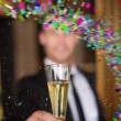 Handsome man holding flute of champagne — Stock Photo #62472381