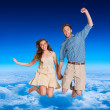Cheerful young couple jumping — Stock Photo #62472709