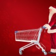 Santa pushes a shopping cart — Stock Photo #62473487