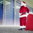 Santa with sack of gifts — Stock Photo #62473495