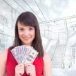 Young woman holding her cash — Stock Photo #62473523