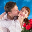 Woman getting roses from man — Stock Photo #62473713
