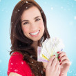 Brunette holding her cash money — Stock Photo #62474729