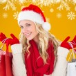 Festive blonde with shopping bags — Stock Photo #62474825