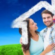 Happy young couple showing new house key — Stock Photo #62475581