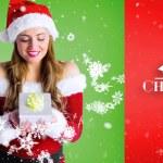 Pretty girl in santa costume holding gift box — Stock Photo #62475777