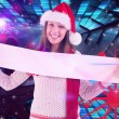 Festive brunette showing blank banner — Stock Photo #62476319