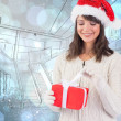 Brunette in santa hat opening gift — Stock Photo #62476461